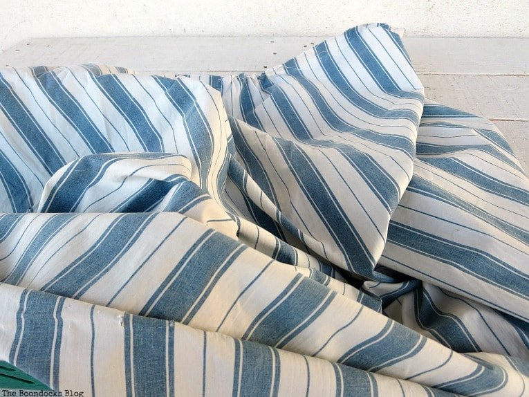 blue striped fabric, How to Easily Upcycle Broken Plastic Baskets www.theboondocksblog.com