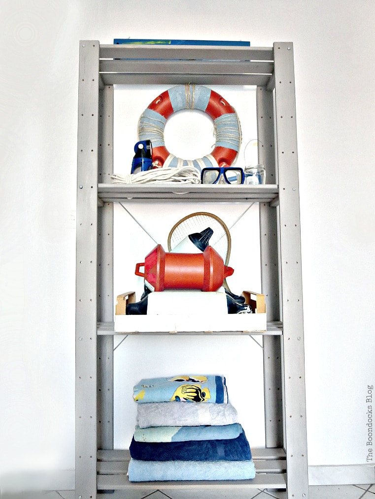 Nautical styled shelf unit, How to Improve an Ikea Hejne with Paint www.theboondocksblog.com