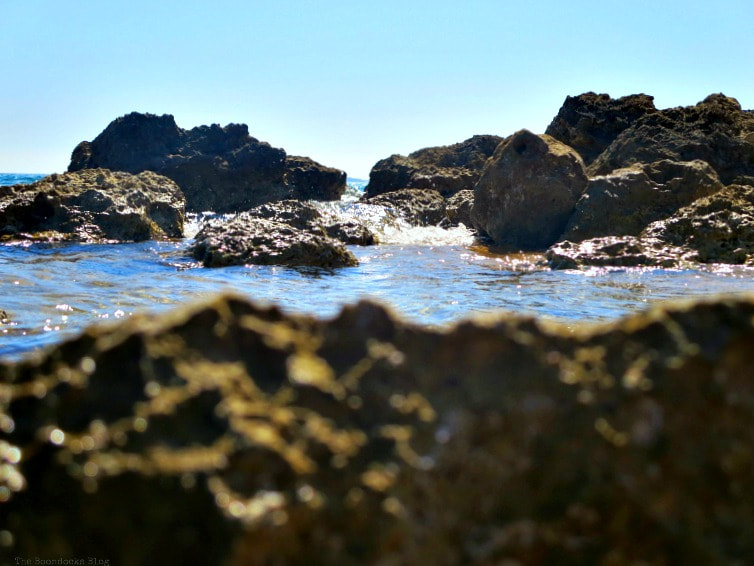 the contrast of the blue water and sky with the brown rocks, Kefalonia in Brown - The Rocky Beaches of the Island www.theboondocksblog.com