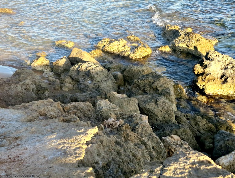 the sun hitting the rocks on the edge, Kefalonia in Brown - The Rocky Beaches of the Island www.theboondocksblog.com