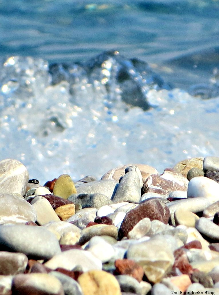 Water hitting the pebbles on the beach, Photo of the Day July 2017 www.theboondocksblog.com