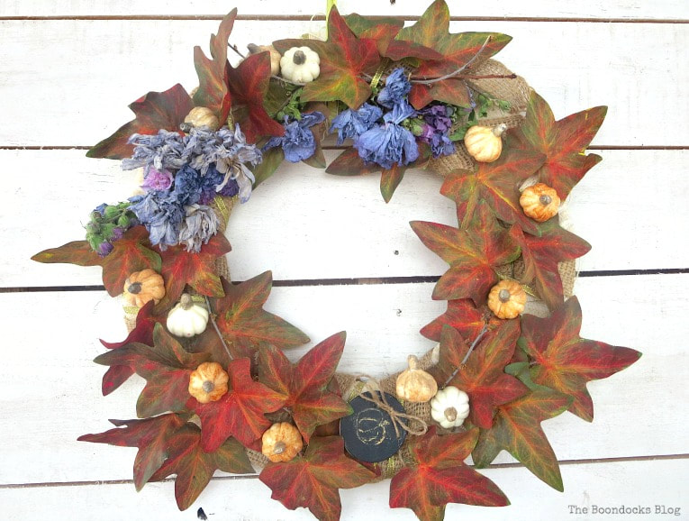 finished fall wreath using dollar store items, How to Make a Beautiful Dollar Store Fall Wreath www.theboondocksblog.com