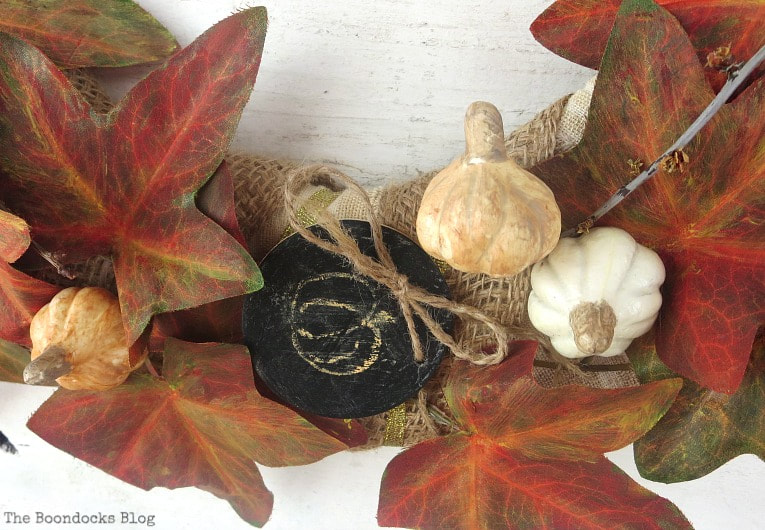 adding random stems, How to Make a Beautiful Dollar Store Fall Wreath www.theboondocksblog.com