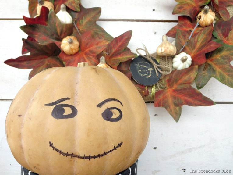 pumpkin man gives his approval, How to Make a Beautiful Dollar Store Fall Wreath www.theboondocksblog.com