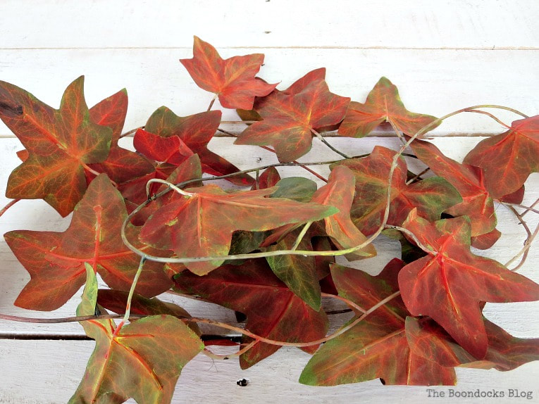 Painted plastic leaves and stems, How to Make a Beautiful Dollar Store Fall Wreath www.theboondocksblog.com
