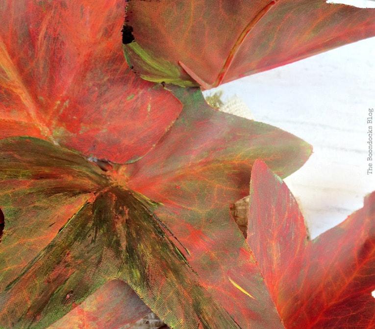 vines tucked under burlap ribbon, How to Make a Beautiful Dollar Store Fall Wreath www.theboondocksblog.com