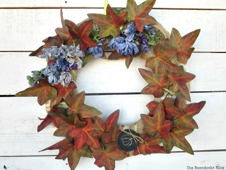 wreath with plastic vines painted and dried flowers, How to Make a Beautiful Dollar Store Fall Wreath www.theboondocksblog.com