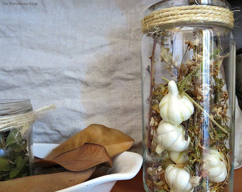 white mini squash in jar, How to Make a Beautiful Dollar Store Fall Wreath www.theboondocksblog.com