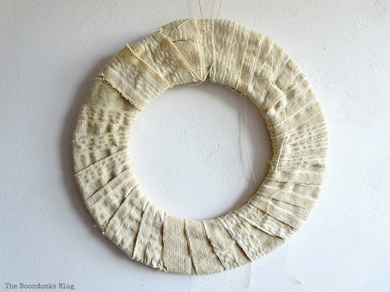 donut shaped cardboard wrapped in white fabric, How to Make a Beautiful Dollar Store Fall Wreath www.theboondocksblog.com