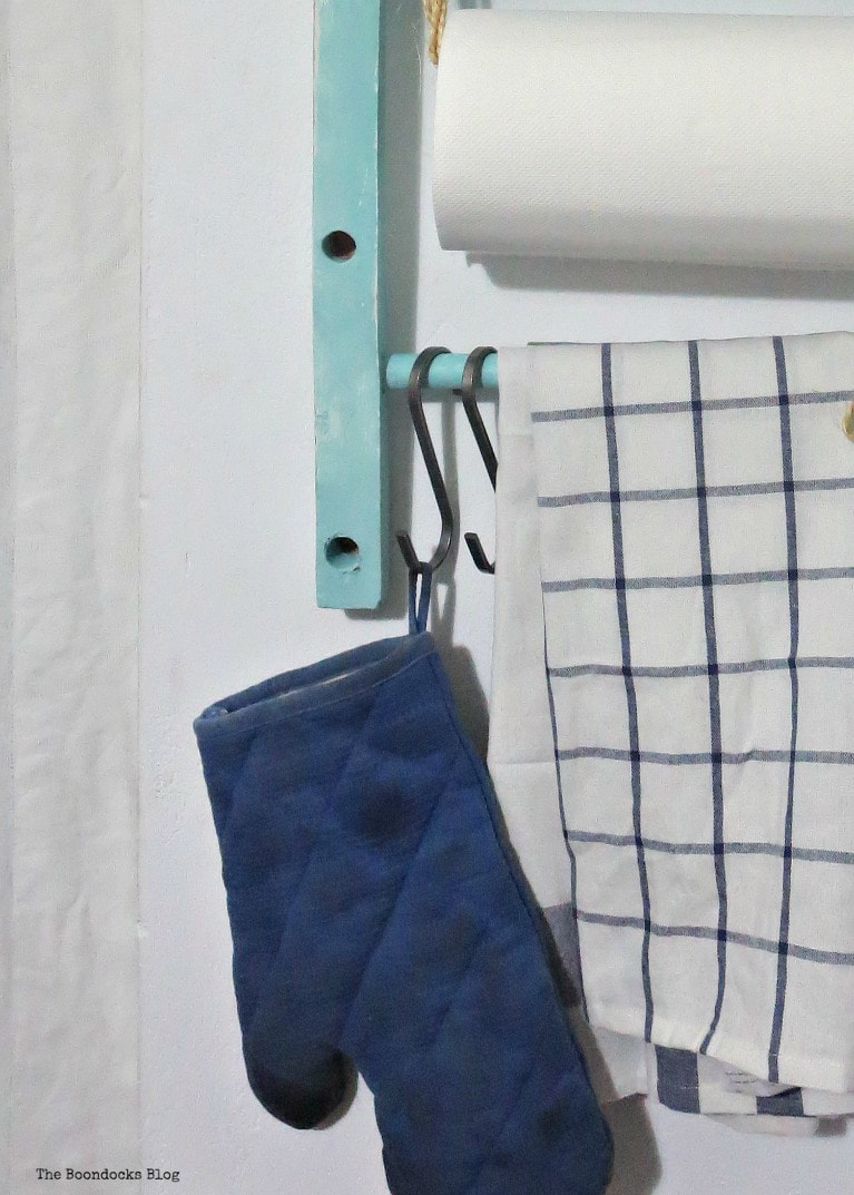 S shaped hooks holding the gloves, How to Make a Cool Kitchen Organizer from a Chair www.theboondocksblog.com