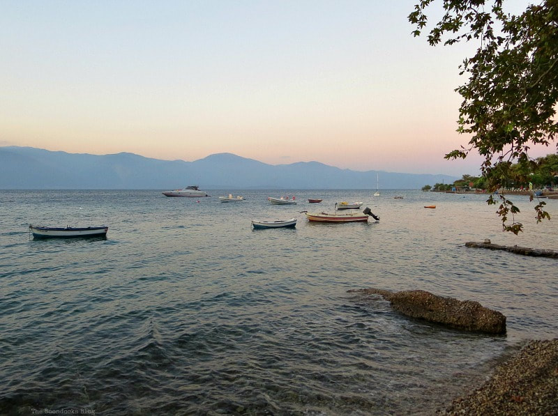 Sunset on the bay with fishing boats in Greece, A Trip with a One-Way Ticket - Fantastic Fifty www.theboondocksblog.com