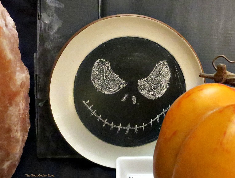 wall plate painted with chalkboard paint and Jack Skeleton drawing, How to Make an Easy and Thrifty Halloween Vignette www.theboondocksblog.com