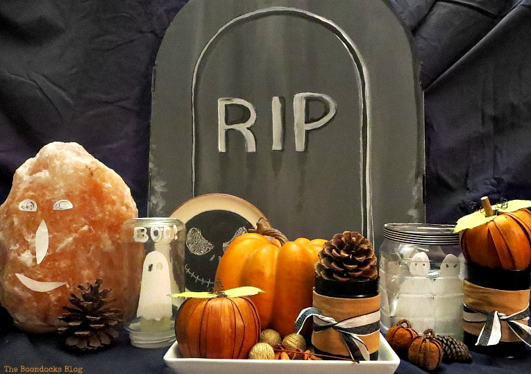 Cardboard box painted as a gravestone, How to Make an Easy and Thrifty Halloween Vignette www.theboondocksblog.com