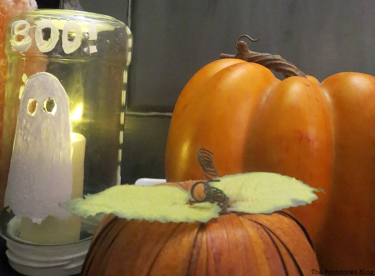 Candle underneath the jar, How to Make an Easy and Thrifty Halloween Vignette www.theboondocksblog.com