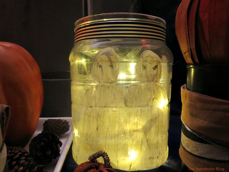 fairy lights inside plastic jar, How to Make an Easy and Thrifty Halloween Vignette www.theboondocksblog.com