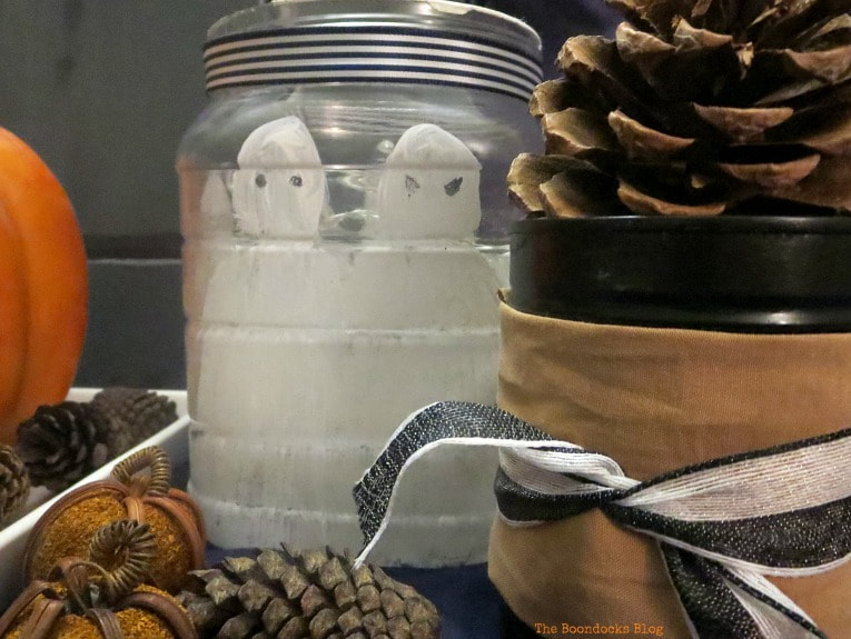 Plastic jar with painted ghosts, How to Make an Easy and Thrifty Halloween Vignette www.theboondocksblog.com