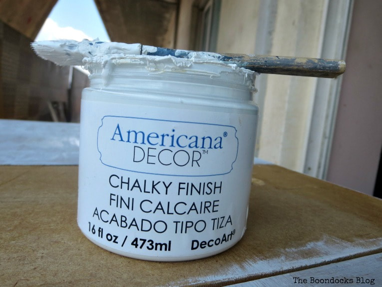 Americana chalky finish type paint used as primer on top, How to Save an Old Laminate Table with Gel Stain www.theboondocksblog.com