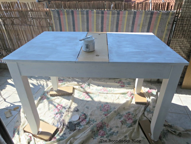 Three coats of chalky type paint on the bottom, How to Save an Old Laminate Table with Gel Stain www.theboondocksblog.com