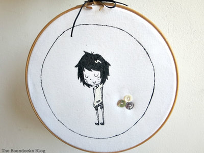 Wall art from a T-shirt in a hoop