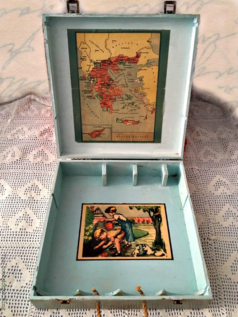 the inside of the box with a map and a page from a children's book, How to Give an