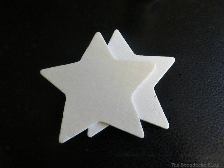2 wooden star cutouts, How to Make Rustic Star Christmas Ornaments www.theboondocksblog.com