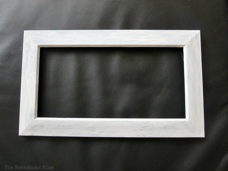 Plastic picture frame painted with chalky type paint, How to make Easy Wall Decor for the Holidays, www.theboondocksblog.com