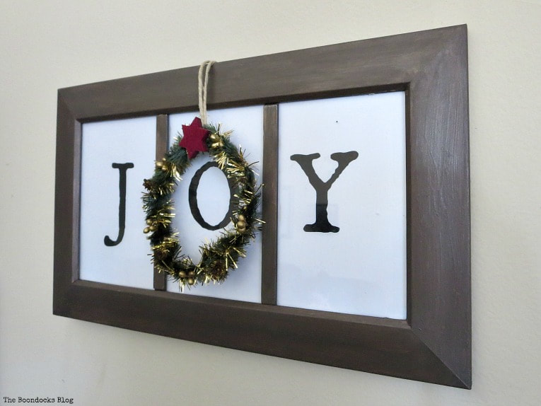 Finished wall decor with the Joy framed words and the Christmas wreath on top, How to make Easy Wall Decor for the Holidays, www.theboondocksblog.com