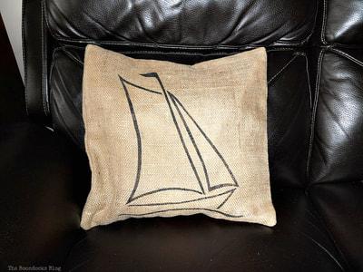 Sailboat pillow on burlap.