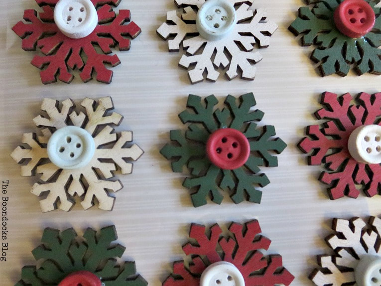 little gift tag embellishments with snowflake and buttons, How to Make Rustic Star Christmas Ornaments www.theboondocksblog.com