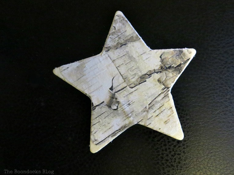 Birch paper decoupaged onto star shape, How to Make Rustic Star Christmas Ornaments www.theboondocksblog.com