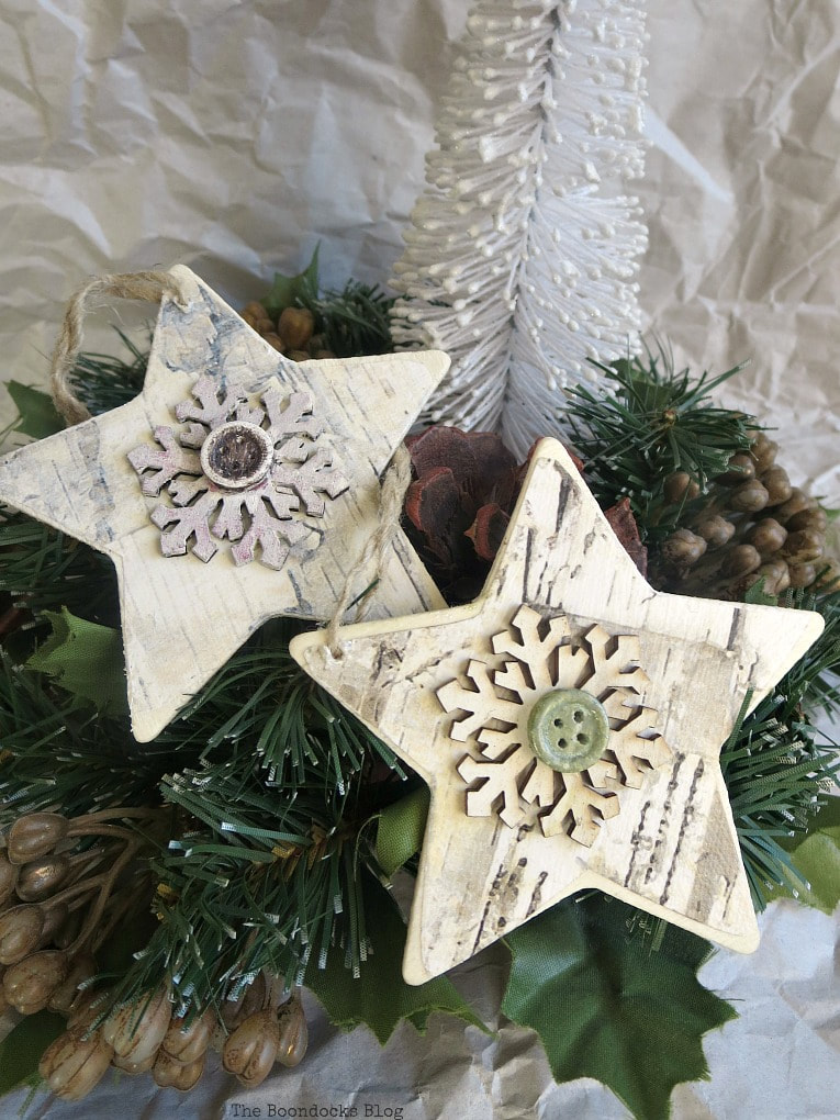 two farmhouse star shaped ornaments, How to Make Rustic Star Christmas Ornaments www.theboondocksblog.com