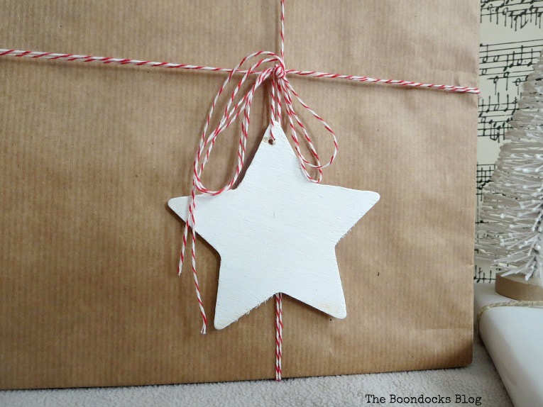 bakers twine in red and white and a white wood star, Three simple gift wrapping ideas for the Holidays, www.theboondocksblog.com
