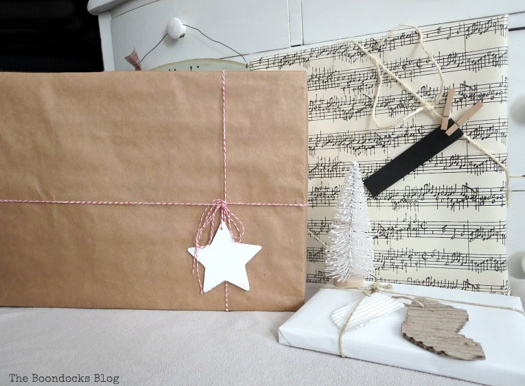 three boxes wrapped in various neutral papers. Three simple gift wrapping ideas for the Holidays, www.theboondocksblog.com