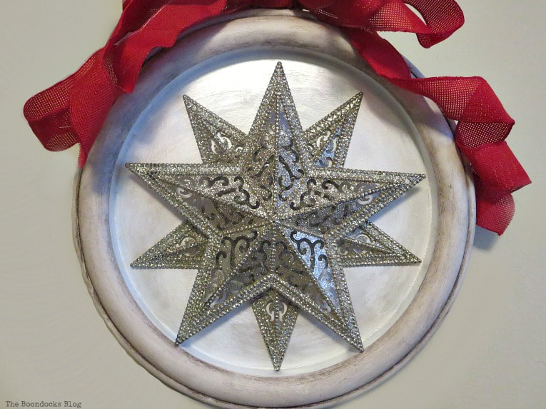 2 clocks set into a clock frame repurposed as Christmas decor, How to Make a Christmas Craft with Dollar Store Items www.theboondocksblog.com