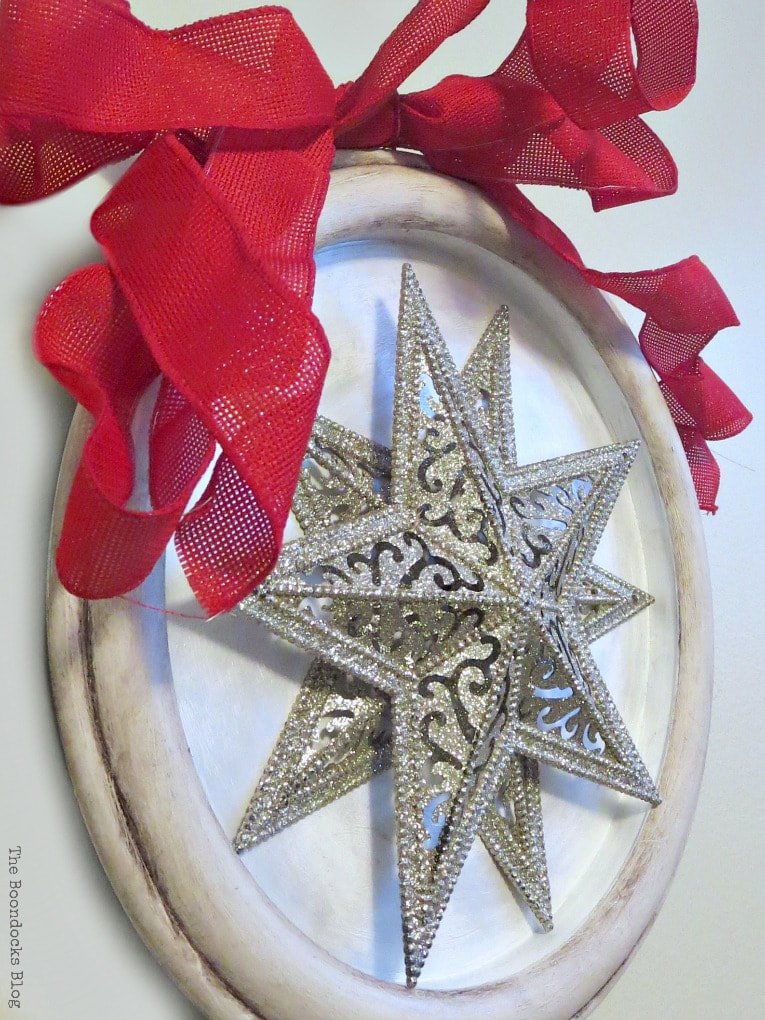 red ribbon on the top of the frame, How to Make a Christmas Craft with Dollar Store Items www.theboondocksblog.com