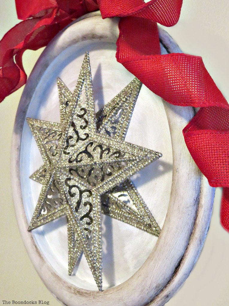 2 stars from the dollar store set into a clock frame, How to Make a Christmas Craft with Dollar Store Items www.theboondocksblog.com