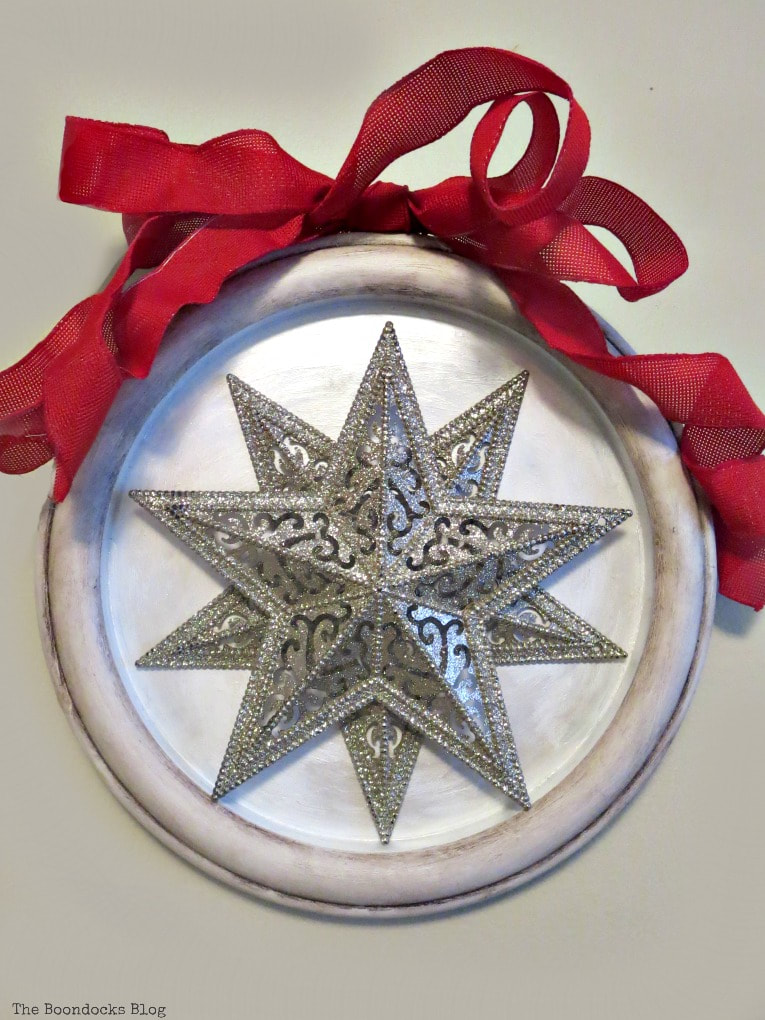 stars attached to the clock frame, How to Make a Christmas Craft with Dollar Store Items www.theboondocksblog.com