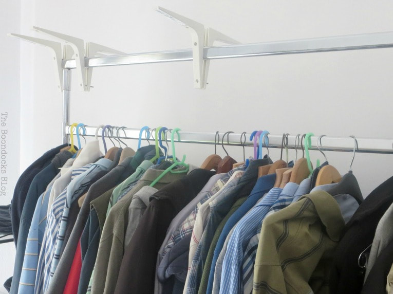 A clothing rack with hangers and clothes.