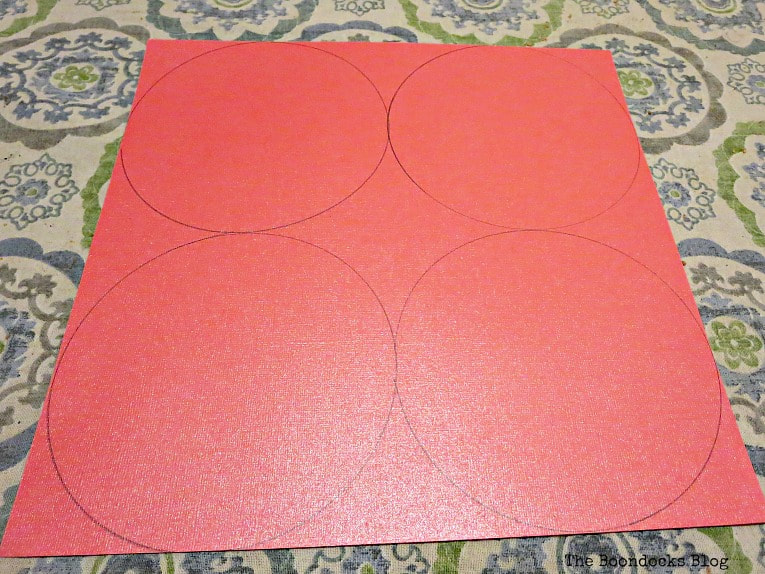 scrapbook paper with four circles outlined, A Heart Shaped Box for Valentine's Day Crafting www.theboondocksblog.com