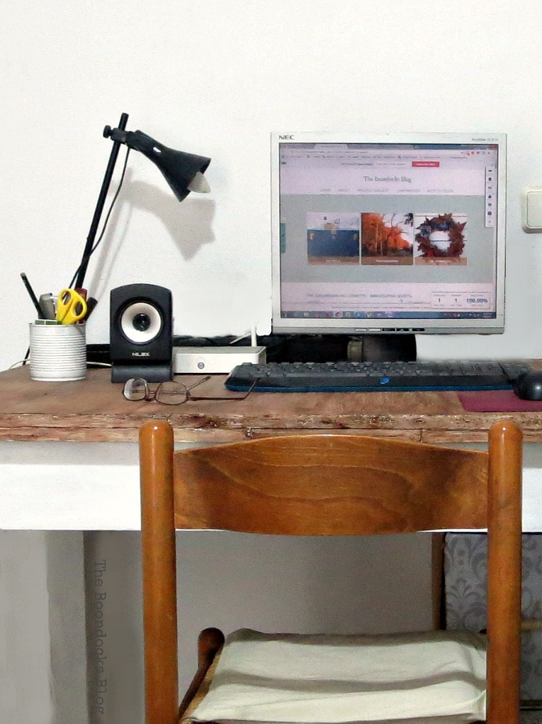 Close up of wooden desk and chair.