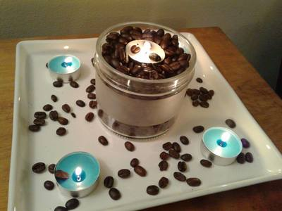 Tea lights set into coffee beans