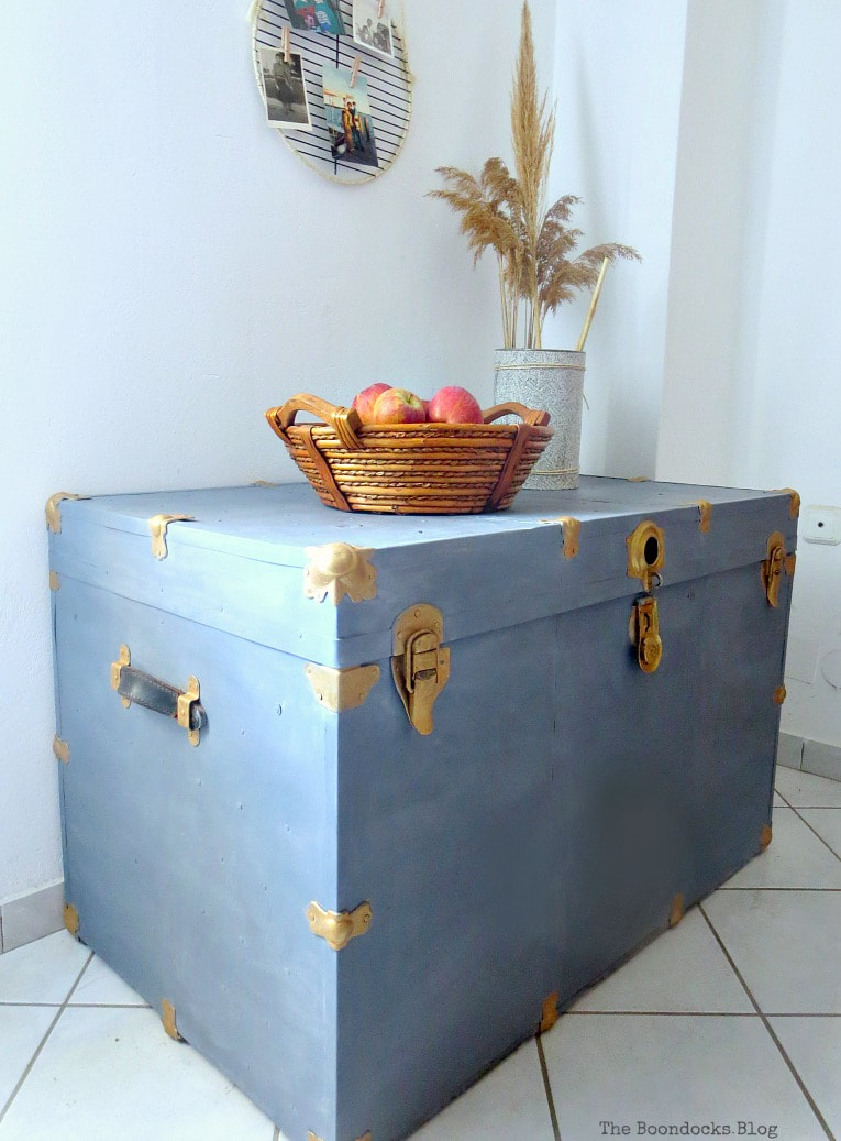 An beat-up vintage metal trunk painted with Old Fashioned Milk Paint.