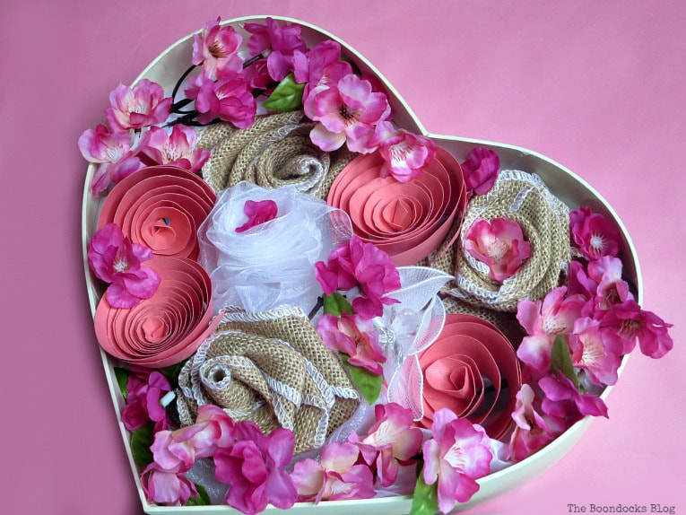all the flowers placed into heart shaped box, A Heart Shaped Box for Valentine's Day Crafting www.theboondocksblog.com