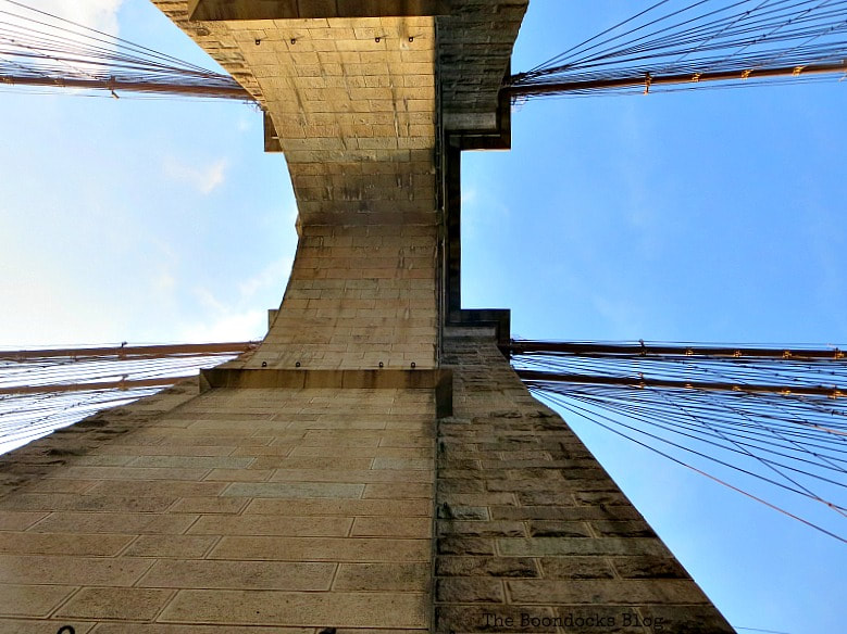 Standing underneath one of the Towers of the Brooklyn Bridge, A Tour of the Astonishing Brooklyn Bridge Walkway www.theboondocksblog.com