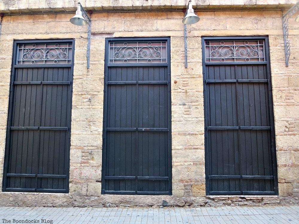 Three black wood doors with upper metal work, Celebrating a 3 year Blogoversary with Lots of Doors www.theboondocksblog.com