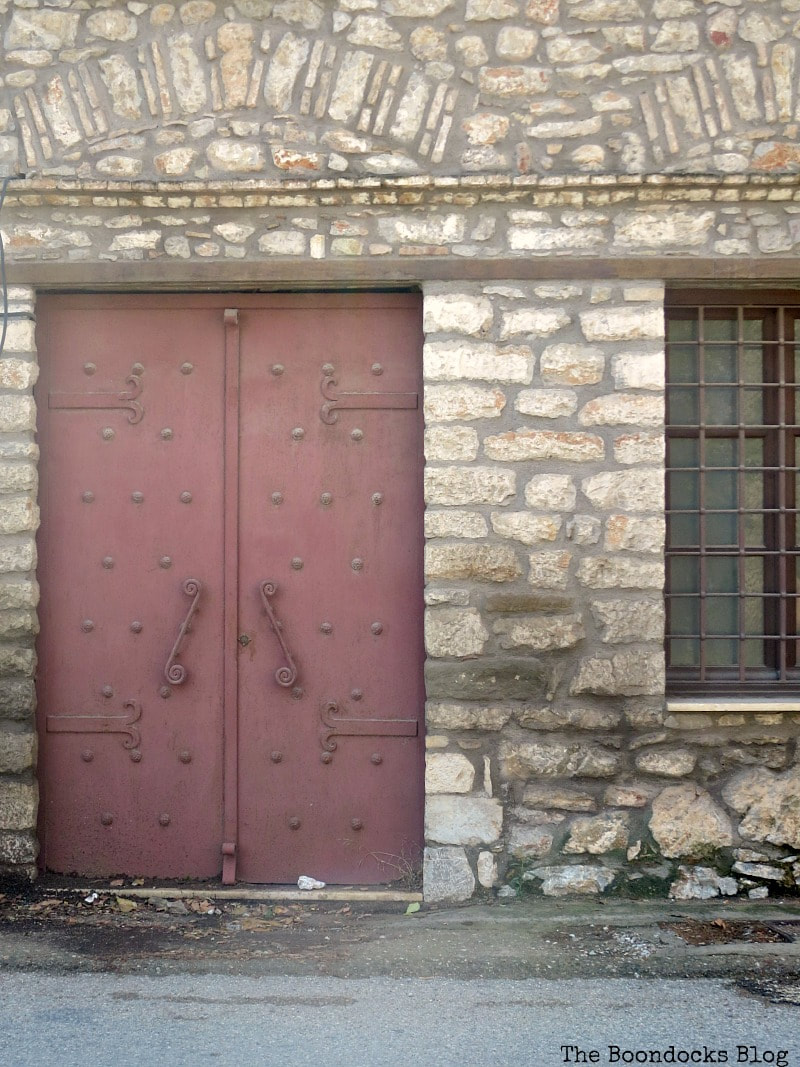 Big metal burgandy door in stone building, Celebrating a 3 year Blogoversary with Lots of Doors www.theboondocksblog.com