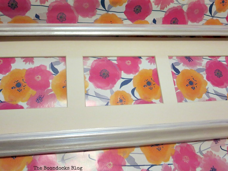 Showing the wrapping paper with bold yellow and pink flowers.