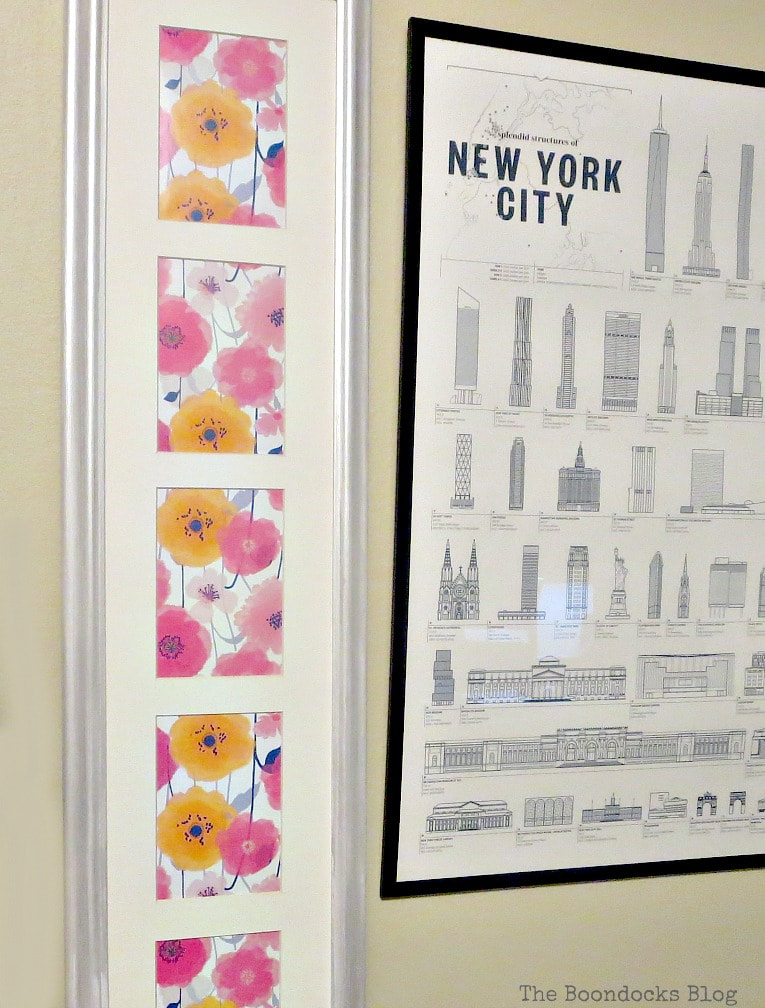 Wrapping paper spring artwork placed beside a New York City poster.
