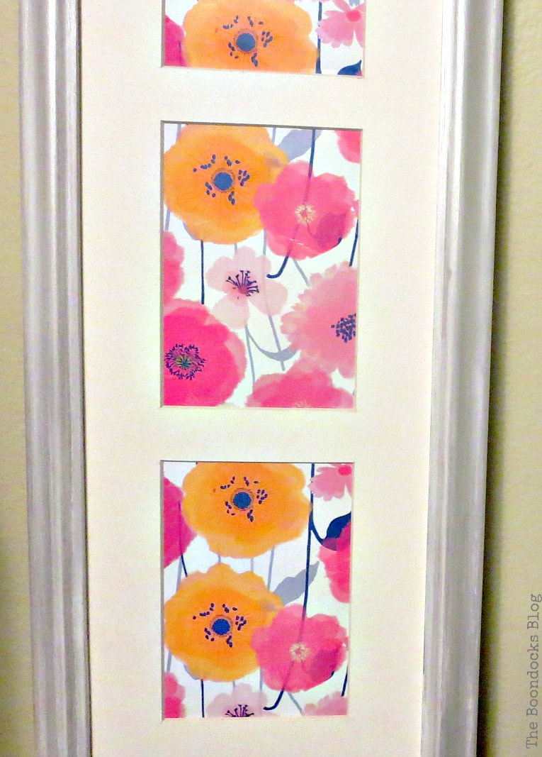 Flower wrapping paper placed inside a frame to make spring artwork.