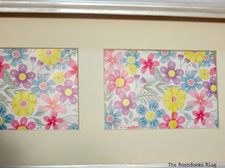 Close up of flower wrapping paper placed into a picture frame.